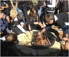 students enjoying the fire pit