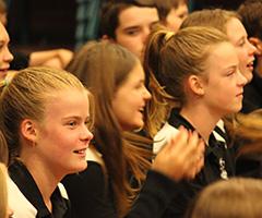 Students enjoying a peformance at school