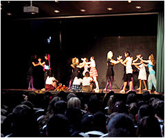 Dance students performing for a school assembly