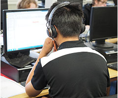 Students working in one of the computer rooms