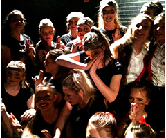 Students backstage having fun during Dancefest