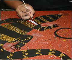 Painting during an aboriginal art workshop