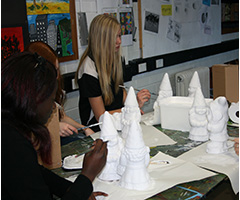 Students preparing their gnomes for Floriade