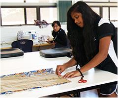 Student enjoying textiles