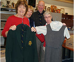 The Archives Team sorting through some old school uniforms