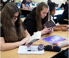 Students reading in English class