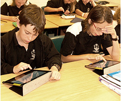 Students using ipads during English classes