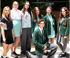 Students modelling the uniforms over the last 78 years